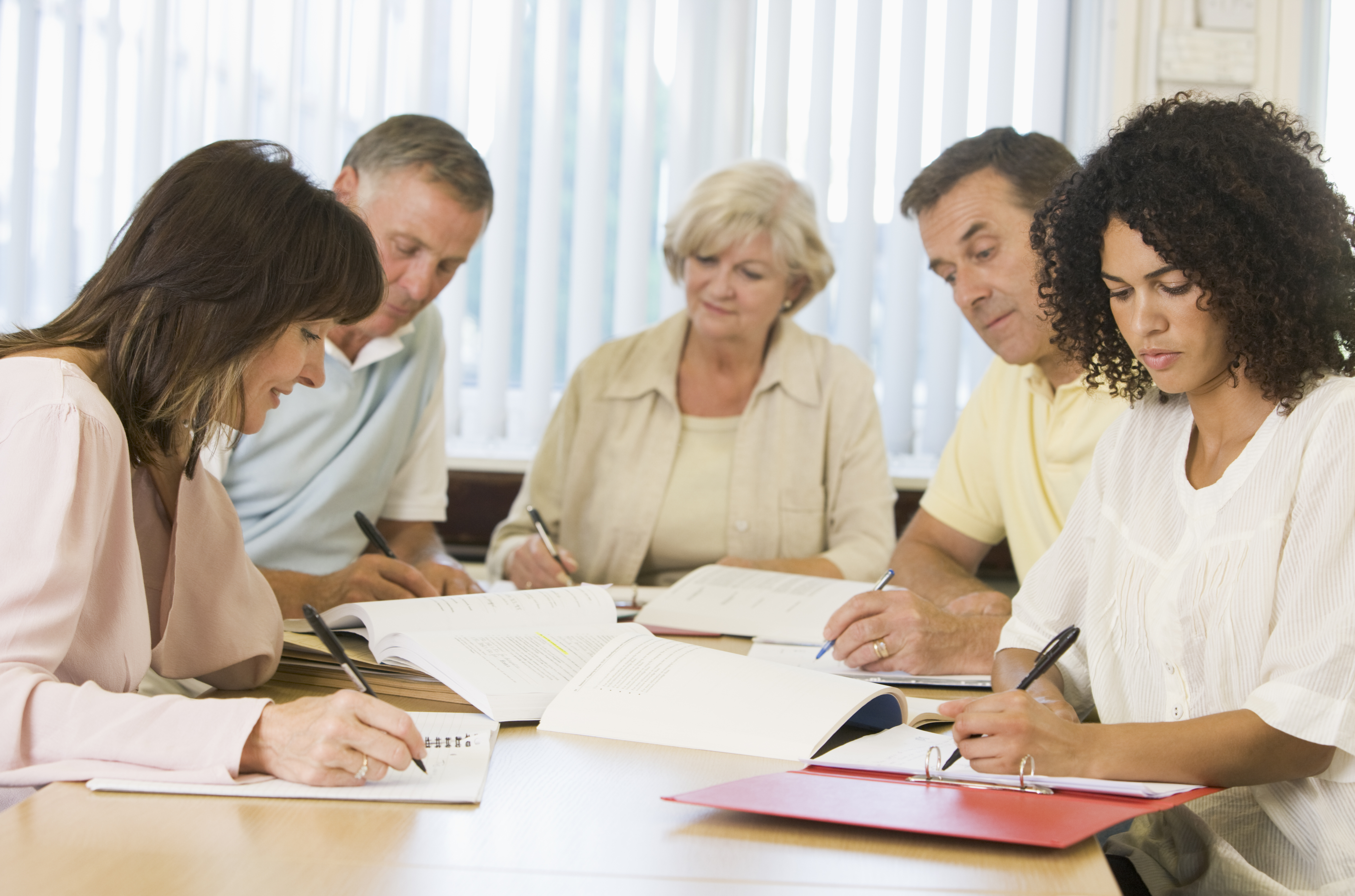 people around meeting table at training