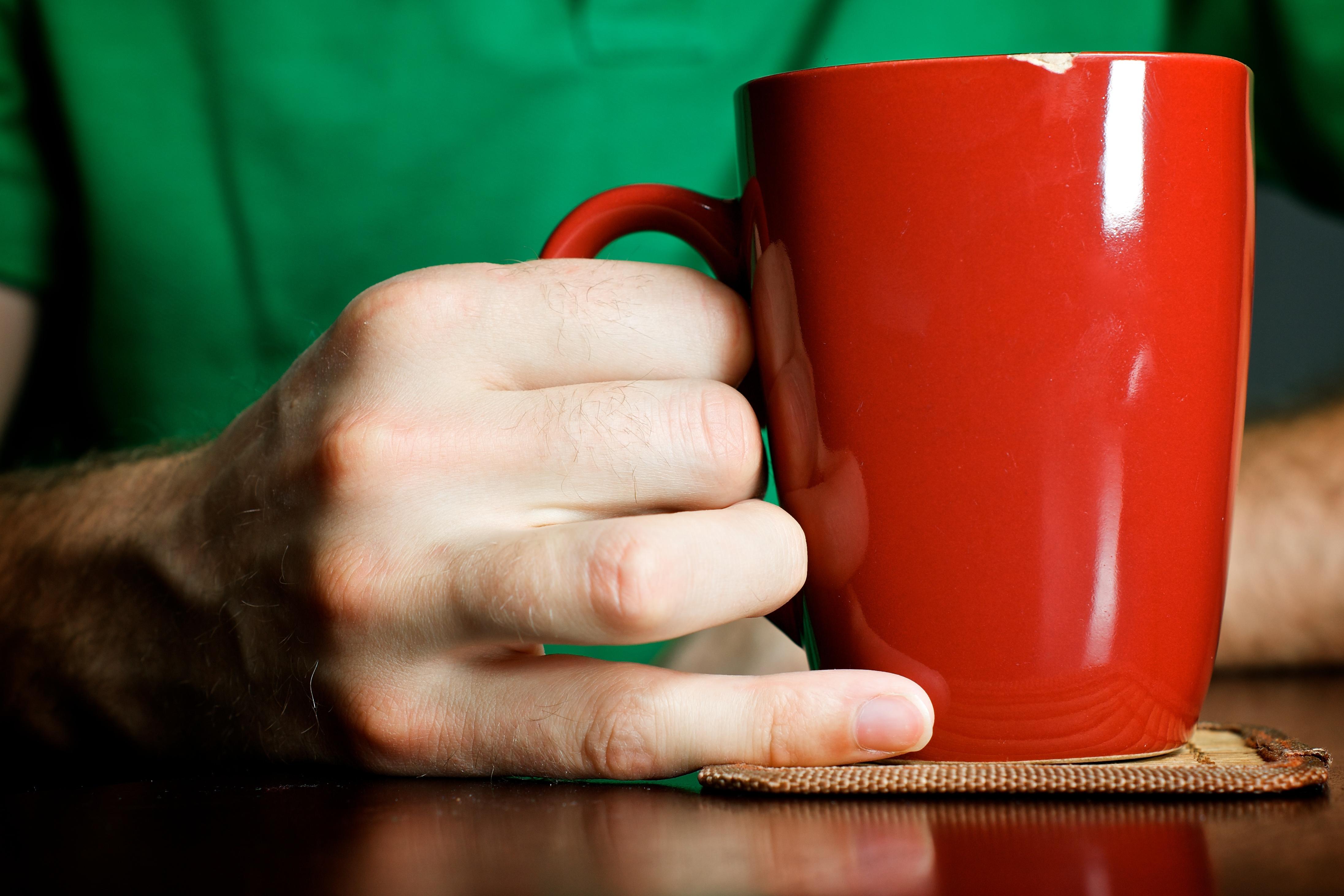 hand holding mug