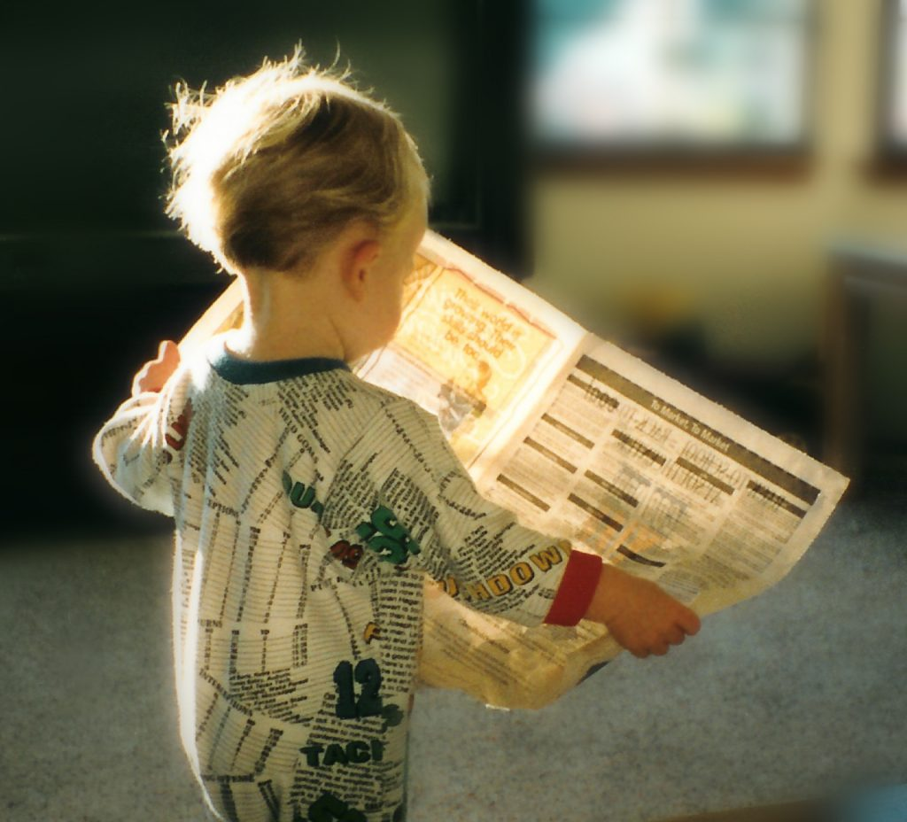 Baby reading a newspaper image by criswatk via sxc.hu