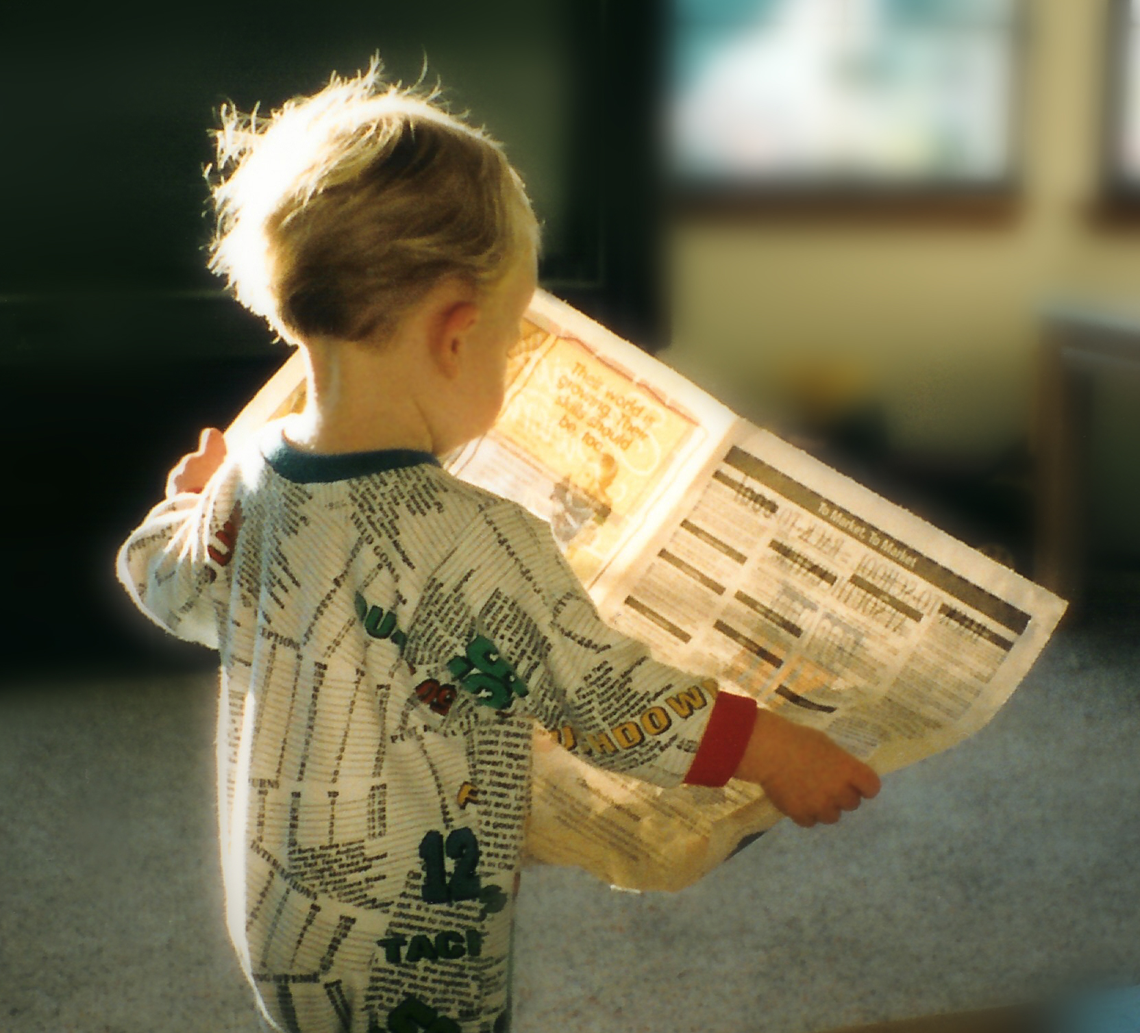 Baby reading a newspaper image by criswatk via sxc.hu