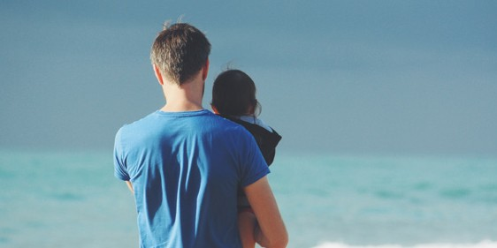 father and child at beach