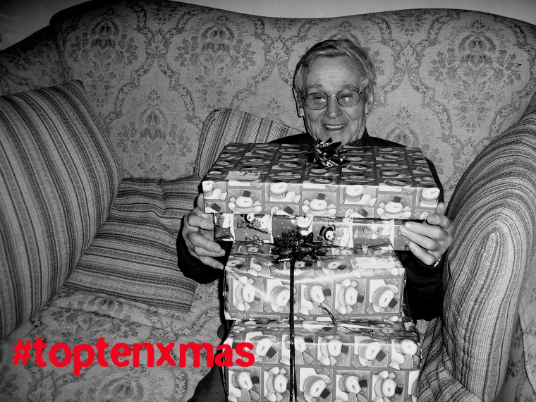 Man holding presents - image via sxc.hu