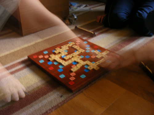 Family playing Scrabble
